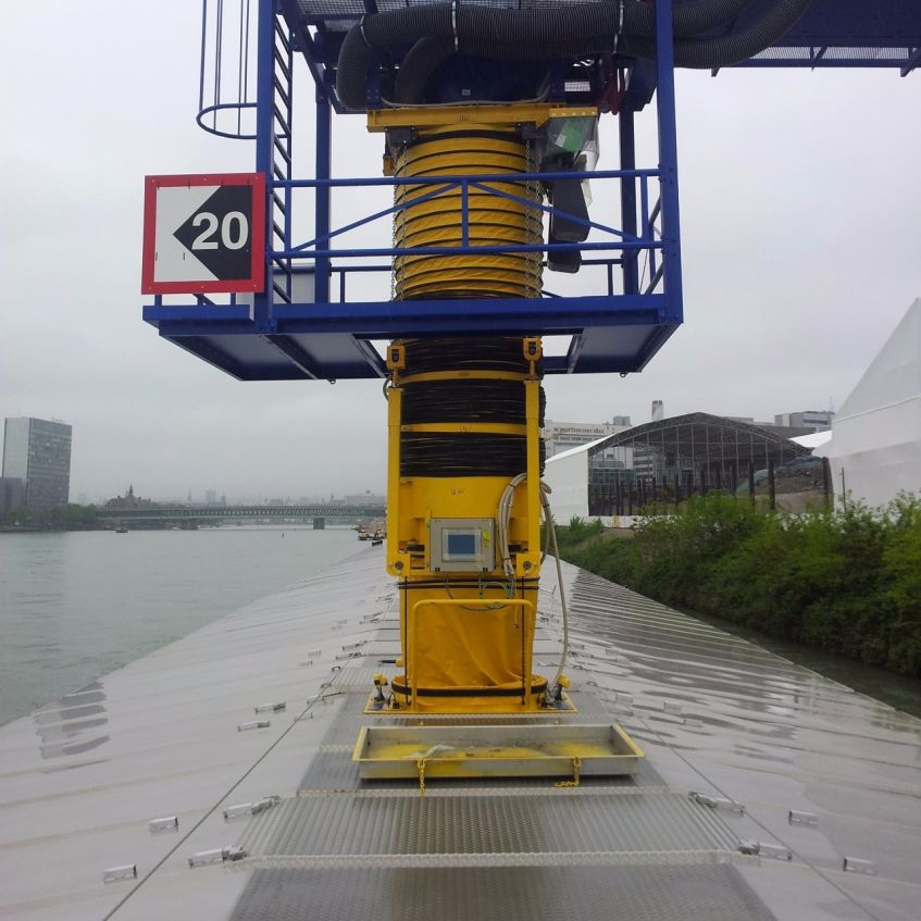 A sealed loading device for hazardous waste from a conveyor belt into a ship